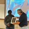"""Cacelia """"Sam"""" Bryson (left) receives a plaque from Jim Spichiger 3765"""